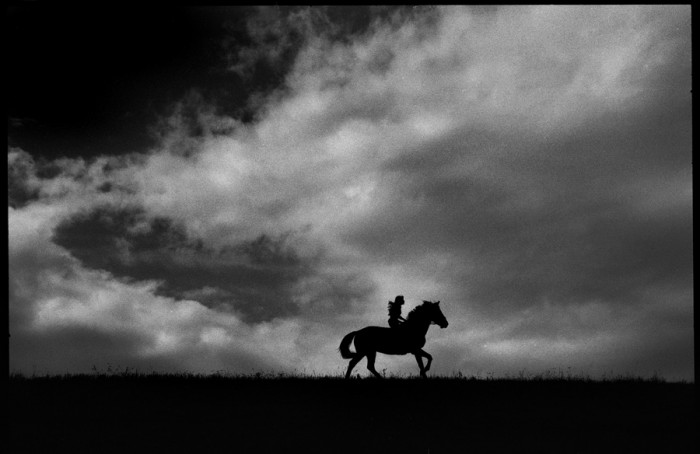 Rides the Black-and-whiteHorse